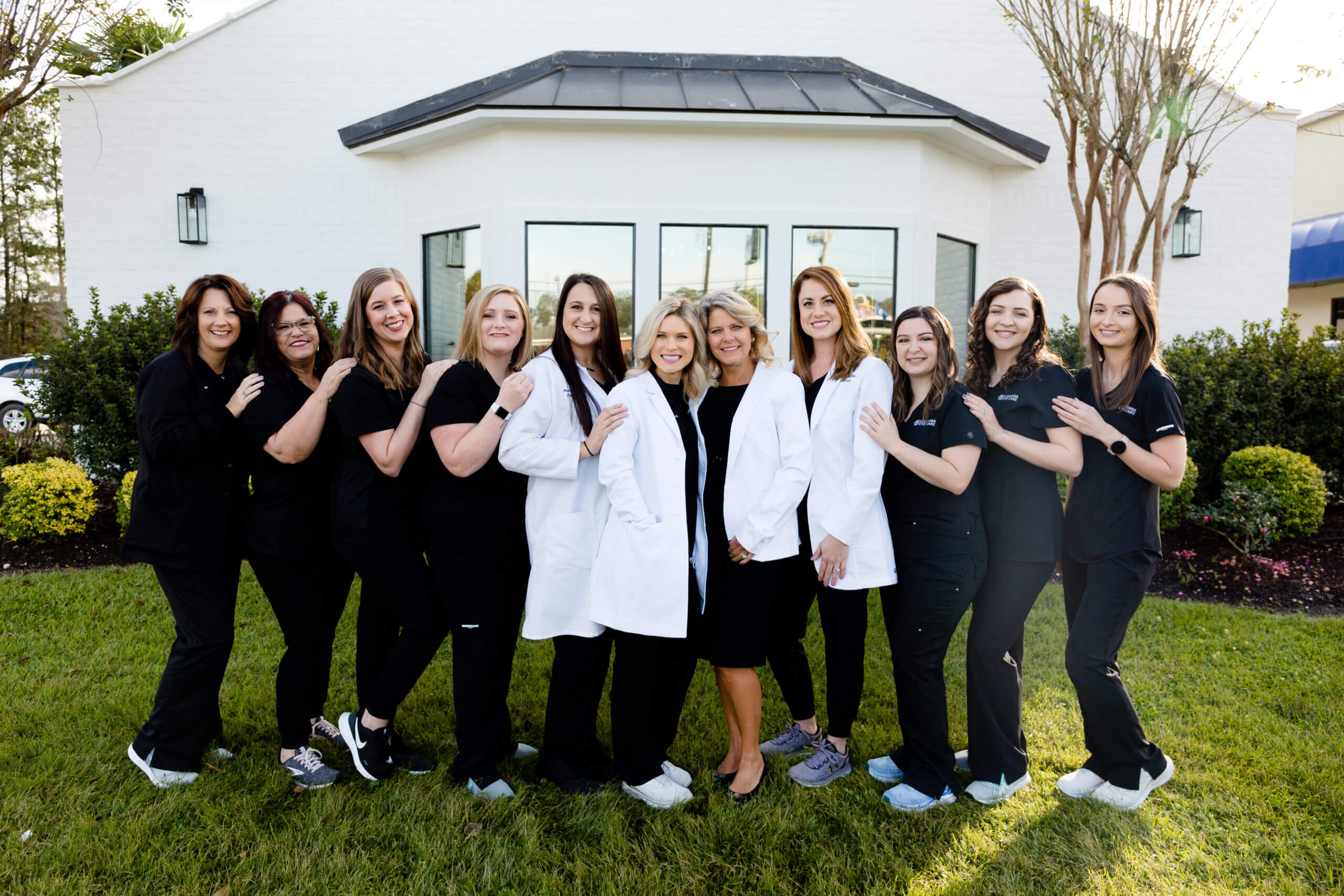Team-Pic-with-Docs-scaled