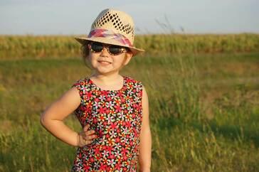 child outside sunglasses