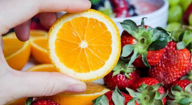 slice orange fruit and strawberries 1116558