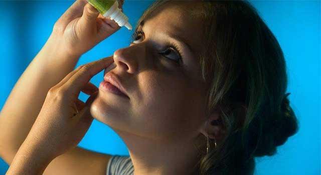 Woman Putting in Eye Drops 1280×480 e1524035985163