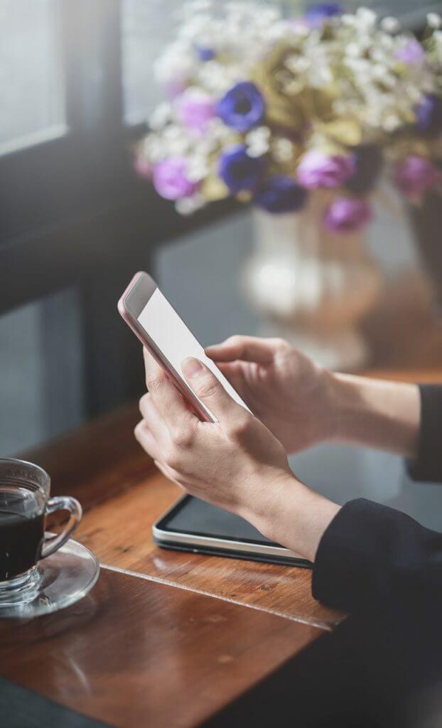 hands desk tablet phone