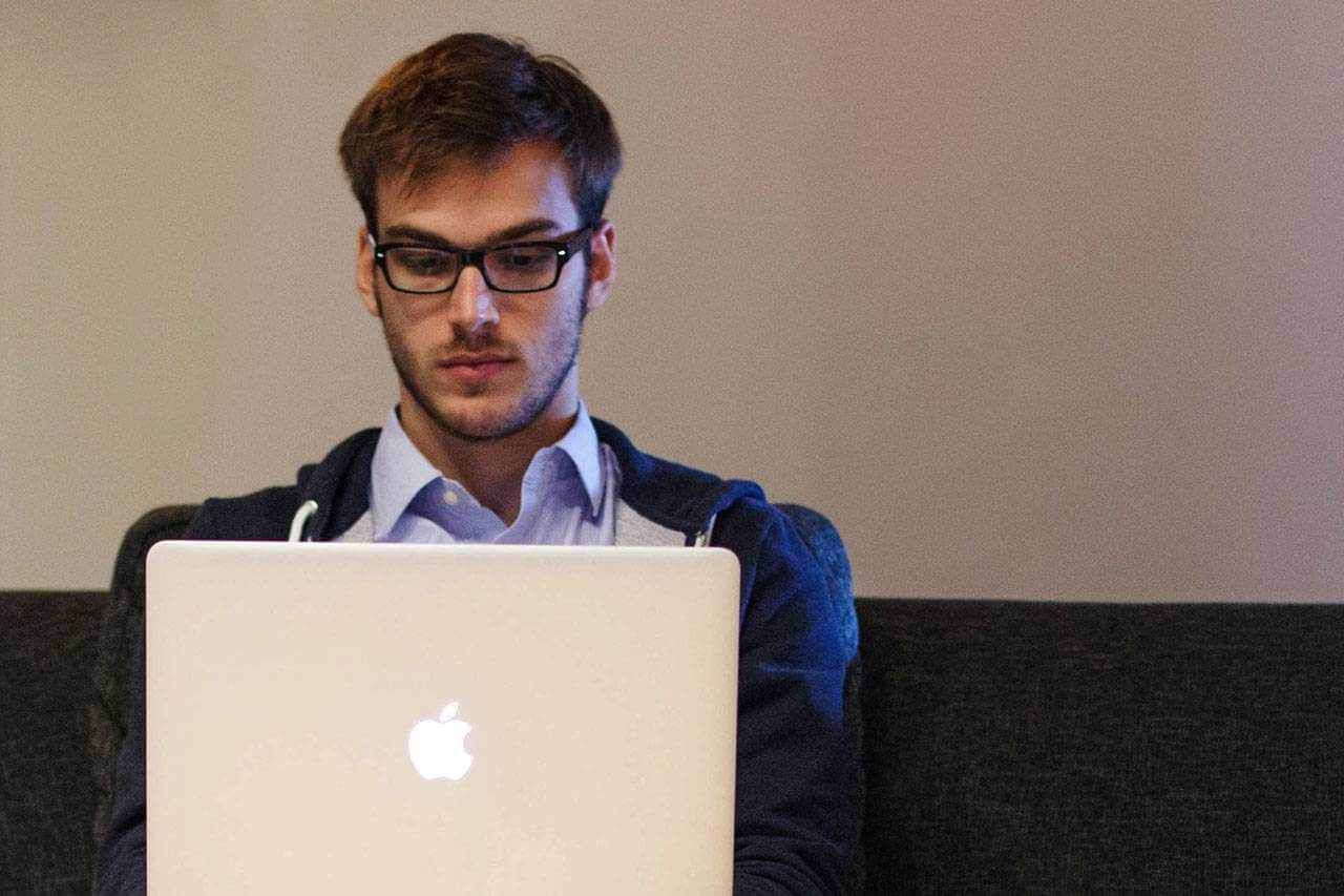Young Man Using Laptop 1280×853