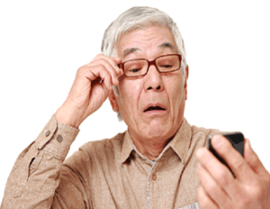 man with glasses rtrying to read