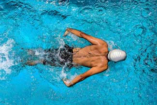 thumbnail person swimming on body of water 863988.jpg