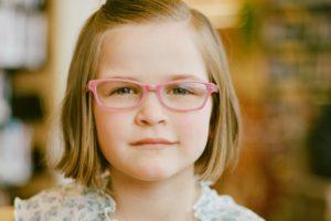 girl in pink eyeglasses