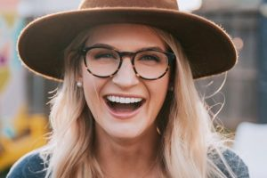 happy woman felt hat eyeglasses