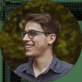 smile man w green glasses 300×300