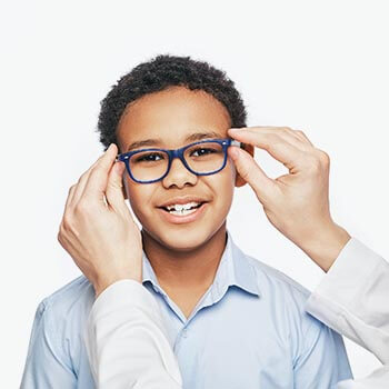 Ophthalmologist Tries On Eyeglasses To African American Little B