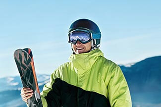 Portrait Of A Skier In The Ski Resort On The Background Of Mount