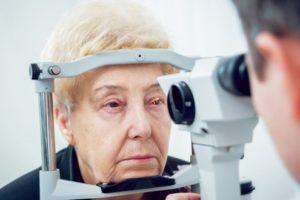 senior woman eye exam optometrist