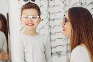 son mother trying on glasses