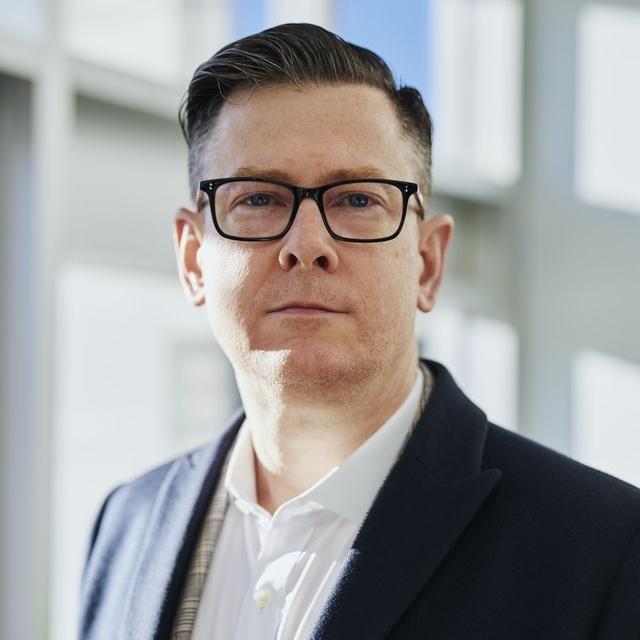 Caucasian man wearing glasses