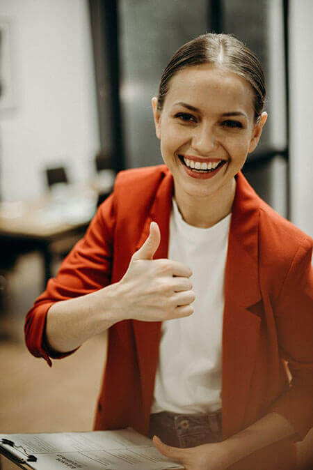 woman thumbs up