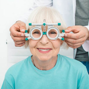 Smiling Senior Woman Wearing Optometrist Trial Frame At Ophthalm