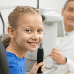 Patient Examining Eyesight In Optician Office. Beautiful Teenage