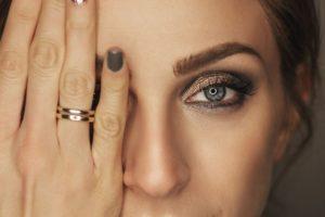 woman hand over eye