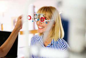 Young Woman Taking An Eyesight Test Examination At An Optician C