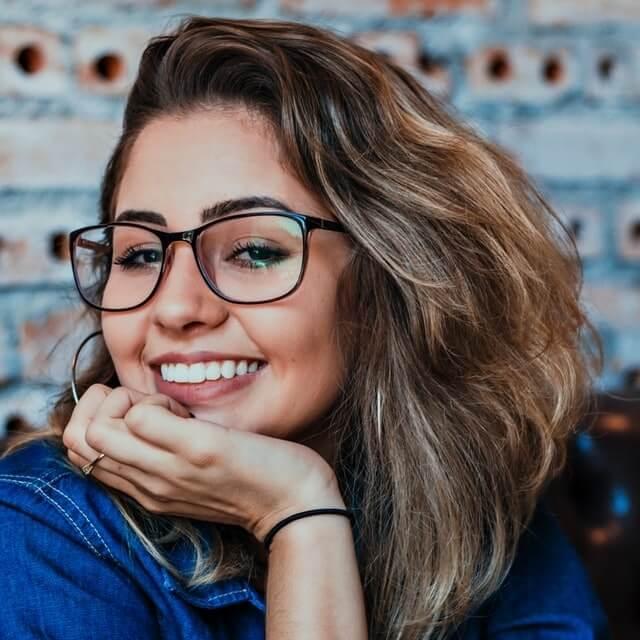 girl smiling wearing eyeglasses 640.jpg