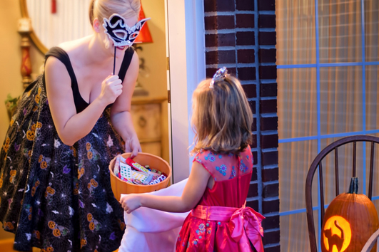 little girl trick or treating on halloween horizontal