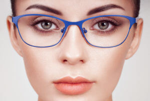 Woman with long eyelashes in eyeglasses