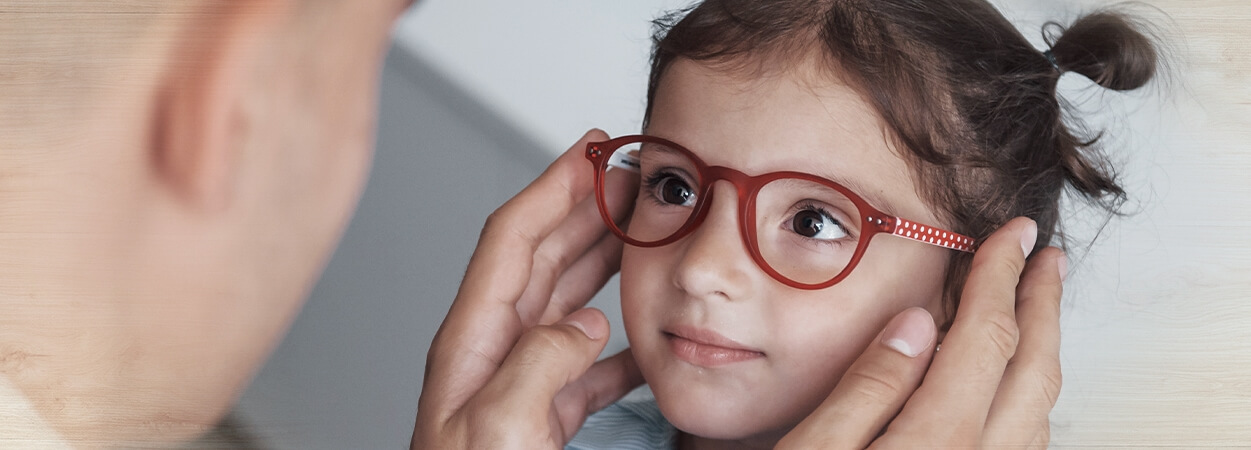 childrens eye exams young girl red glasses