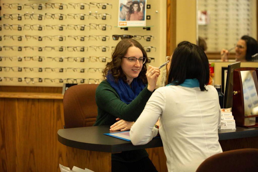 Woman selecting glasses