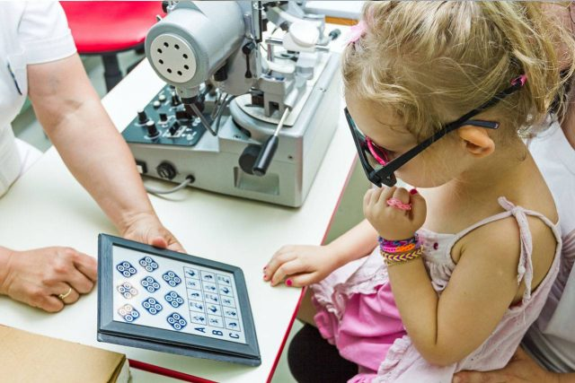 Optometrist, little girl at eye exam in West Palm Beach, Florida