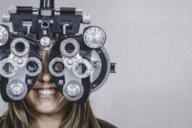 Eye doctor, woman at an eye exam in West Palm Beach, Florida