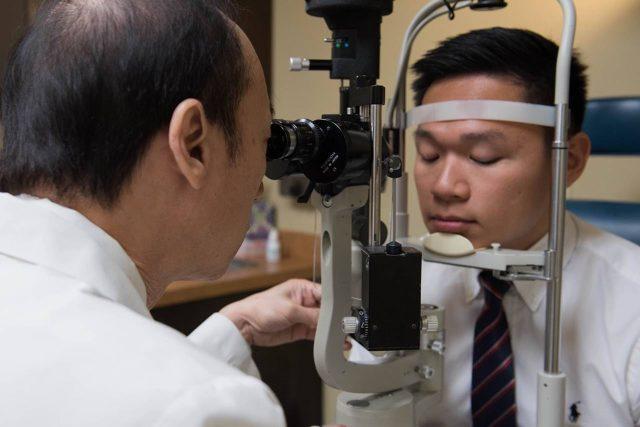 Eye doctor, man at an eye exam in Boca Raton, Florida