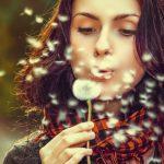 woman blowing flower, optometrist near you treats eye allergies