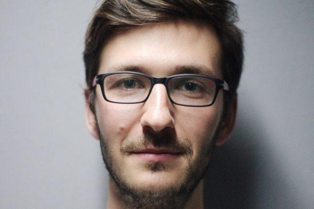 young man glasses portrait 1280x853