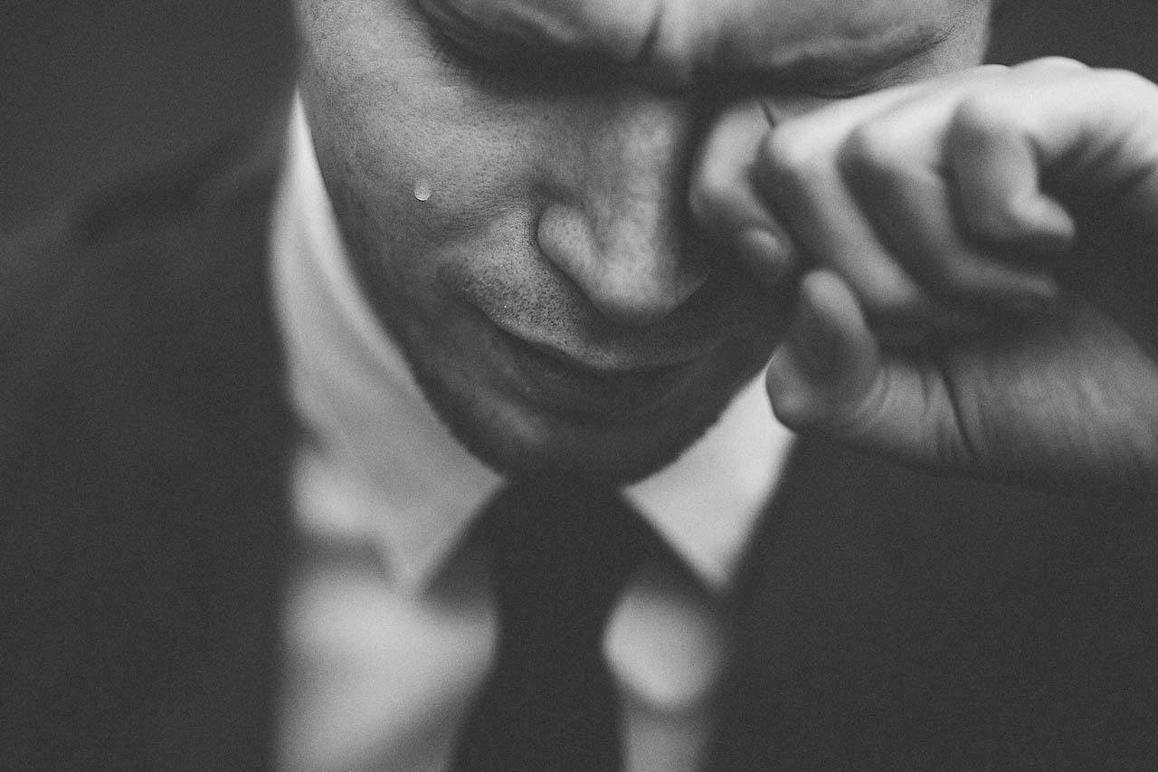 man with dry eyes, rubbing eye