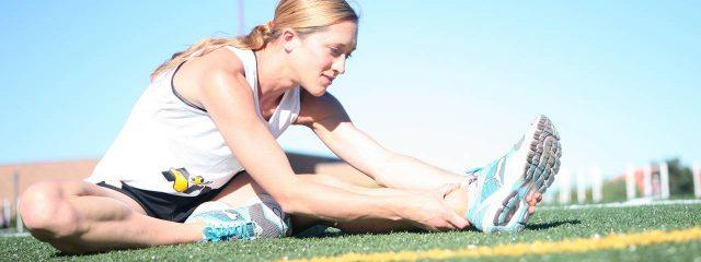 sports female runner stretching 1280x480 640x240