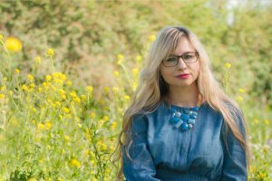 Woman Glasses Sitting in Grass 1280×853