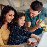 A happy family using a laptop, Eye Care in Las Vegas, NV