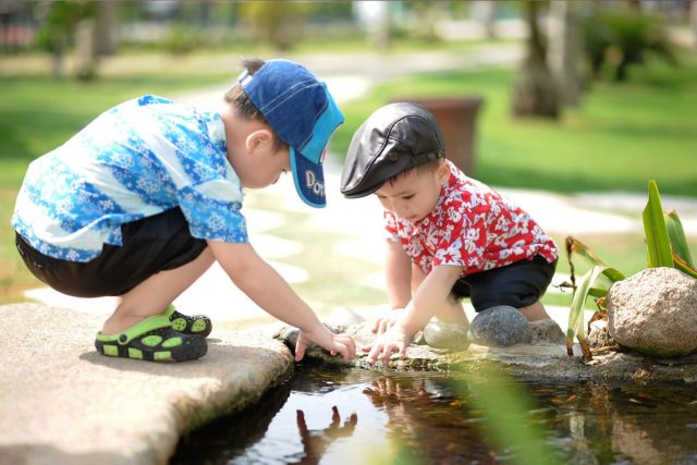 Eye doctor, little boys playing outside in Wilder, Kentucky