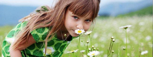 Eye care, girl in the field of flowers in Fairhope, Alabama