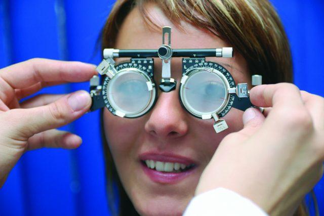 Eye doctor, woman at an eye exam in Fairhope, AL