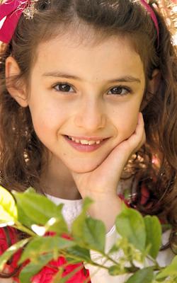 close up of brown eyed brunette child vertical slide