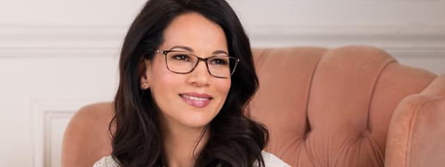 Eye doctor, woman wearing Dana Buchman eyeglasses in Hartsdale, NY