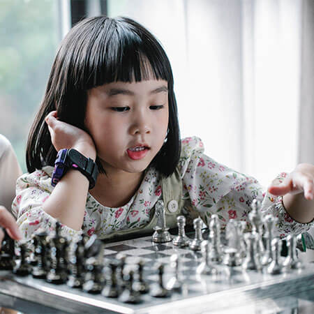 asian girl playing chest 450