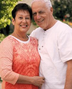senior couple in orange and white