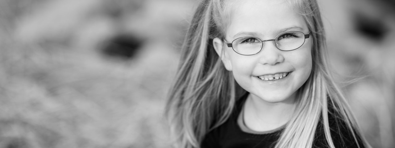 Young Girl Smiling Glasses 1280x853 1280x480