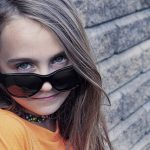 eye exam, Girl wearing sunglasses after orthokeratology in Algonquin, Illinois