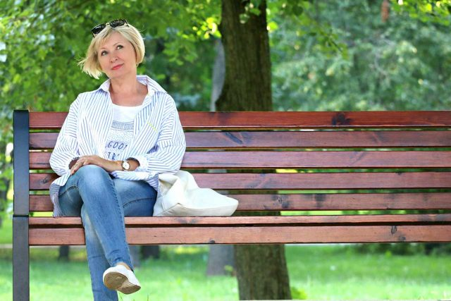 eye doctor, Woman sitting on bench, wearing scleral contact lenses in Algonquin, Illinois