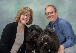 Dr Bill and Dr. Elizabeth with their dogs Arnie and Otis compressed
