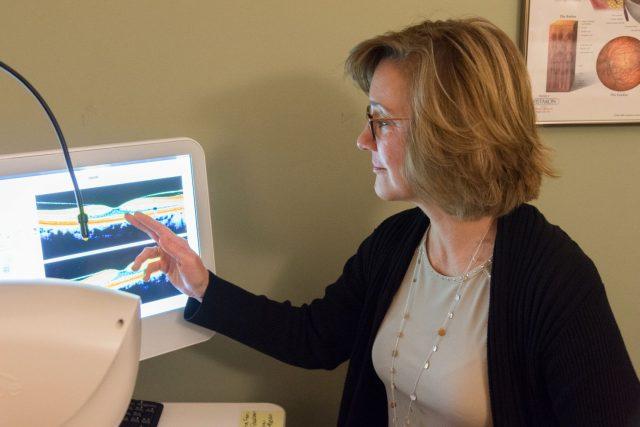 dr elizabeth atkinson oct examining retinal image macula compressed