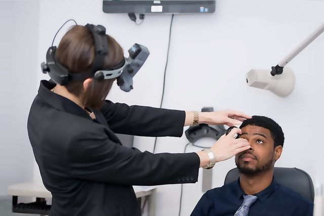 Eye doctor, man getting his eyes checked in in Salmon Arm & Chase, BC