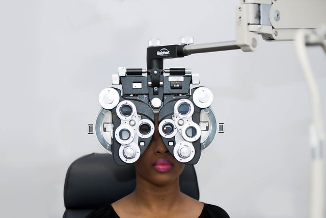 Eye  doctor, woman at an eye exam in Salmon Arm, BC