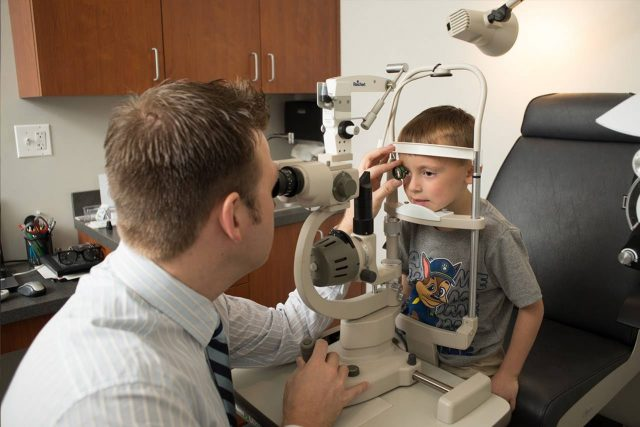 Optometrist, little boy at an eye exam in Salmon Arm & Chase, BC